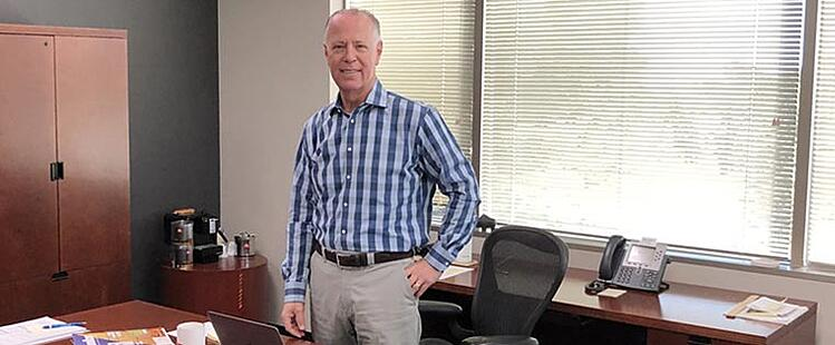 Adam Warner, President, Key Equipment Finance at desk