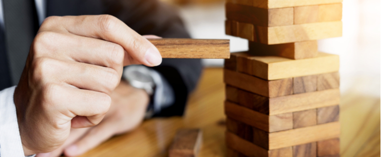financing professional playing Jenga